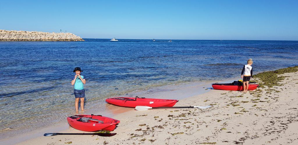 Kayaks on beach on the outsite of Mindarie Marina